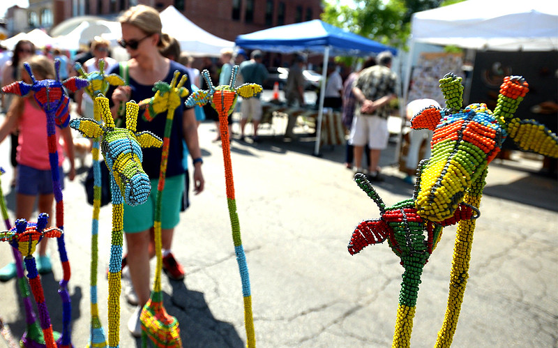 Beaded giraffe catch the eye at Hakuna  Matata Arts during the Ambler Arts & Music Fest June 18, 2016. __ BOB RAINES-- DIGITAL FIRST MEDIA