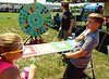 Harry Mobley, right, reacts as his number comes up on the prize wheel spun by Tyler Moffit of the Lifesavers team at the North Penn Relay for Life June 18, 2016. Not looking particularly impressed is Mobley's sister, Aubrey. __ BOB RAINES--DIGITAL FIRST MEDIA
