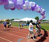 Walkers pass beneath an archway of balloons during the North Penn Relay for Life at the high school's Crawford Stadium June 18, 2016. __ BOB RAINES--DIGITAL FIRST MEDIA