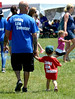 Mike Cossentino holds hands with his daughter, Alyssa, as they walk through the infield to an activity at North Penn Relay for Life June 18, 2016. __ BOB RAINES--DIGITAL FIRST MEDIA