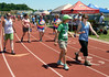 Walkers circle the track during the North Penn Relay for Life at the high school's Crawford Stadium June 18, 2016. __ BOB RAINES--DIGITAL FIRST MEDIA