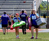 Liz Stowfis and her daughter, Maria, haul their gear to the Team M&M tent at the North Penn Relay for Life at the high school's Crawford Stadium June 18, 2016. __ BOB RAINES--DIGITAL FIRST MEDIA