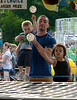 Steve Rhyner holds Mason Sorrino so he and Eva Jones can throw wiffle balls hoping to win a prize at the Perkasie Fire Company Carnival June 28, 2016. _ BOB RAINES--DIGITAL FIRST MEDIA