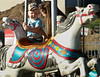 Amanda Lodge holds onto her son, Caden, as they ride the carousel at the Ambler Kiwanis Carnival June 29, 2016. _ Bob Raines | Digital First Media