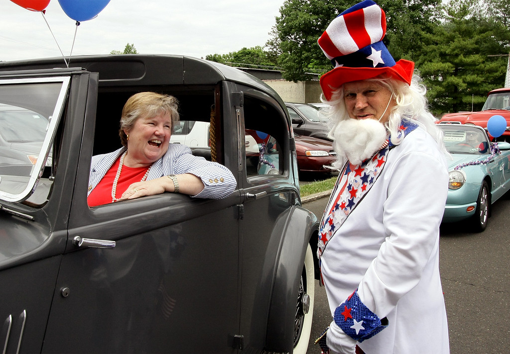 ". PA State Rep. Kate Harper, Rep-61st, shares a laugh with Lee ""Uncle Sam\"" Ford before the start of the North Wales Independence Day Parade July 4, 2016. _ Bob Raines 