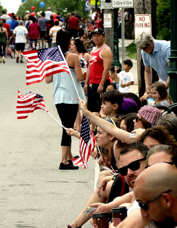 . Young people wave American flags along Main St. during the North Wales Independence Day Parade July 4, 2016. _ Bob Raines | Digital First Media