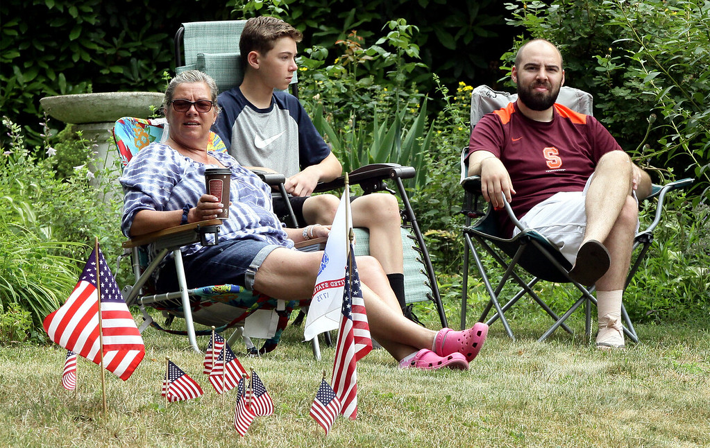 . North Wales residents get an elevated view of the Independence Day Parade from their front lawn July 4, 2016. _ Bob Raines | Digital First Media