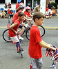Decorated bicycles, a scooter, and a pogo stick make their way along Main St. during the North Wales Independence Day Parade July 4, 2016. _ Bob Raines | Digital First Media