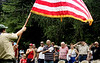Area residents honor the flag at the start of activities in Weingartner Park following the North Wales Independence Day Parade July 4, 2016. _ Bob Raines | Digital First Media
