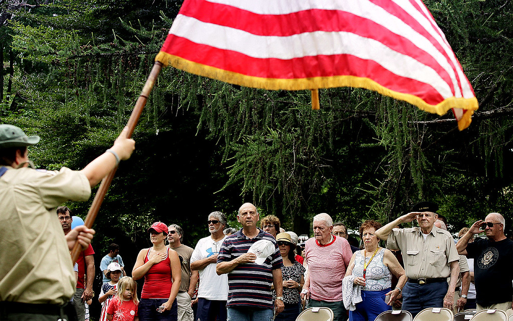 . Area residents honor the flag at the start of activities in Weingartner Park following the North Wales Independence Day Parade July 4, 2016. _ Bob Raines | Digital First Media