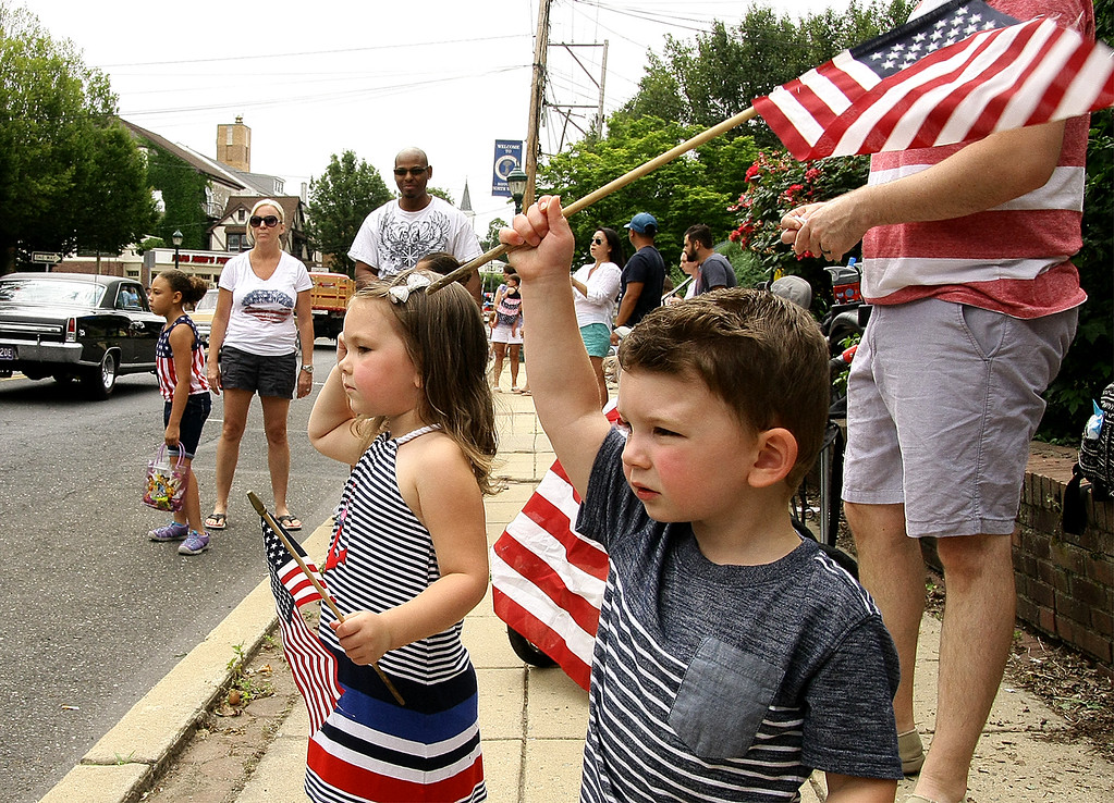 . Elyse and Owen Robbins wave their flags at the North Wales Independence Day Parade July 4, 2016. _ Bob Raines | Digital First Media
