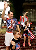 Andrew Burke, his children, Patrick and Millie, and his mother, Marcia Burke, wave during the North Wales Independence Day Parade July 4, 2016. They are originally from Australia. _ Bob Raines | Digital First Media