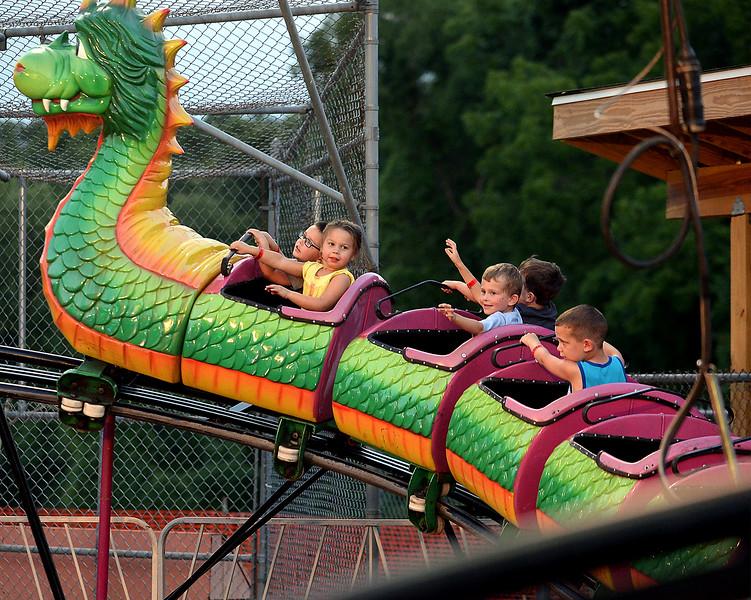 Children ride a dragon roller coaster at the Southampton Days fair July 6, 2016. _ Bob Raines | Digital First Media