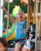 A girl charges round the carousel on a charger at the Southampton Days fair July 6, 2016. _ Bob Raines | Digital First Media