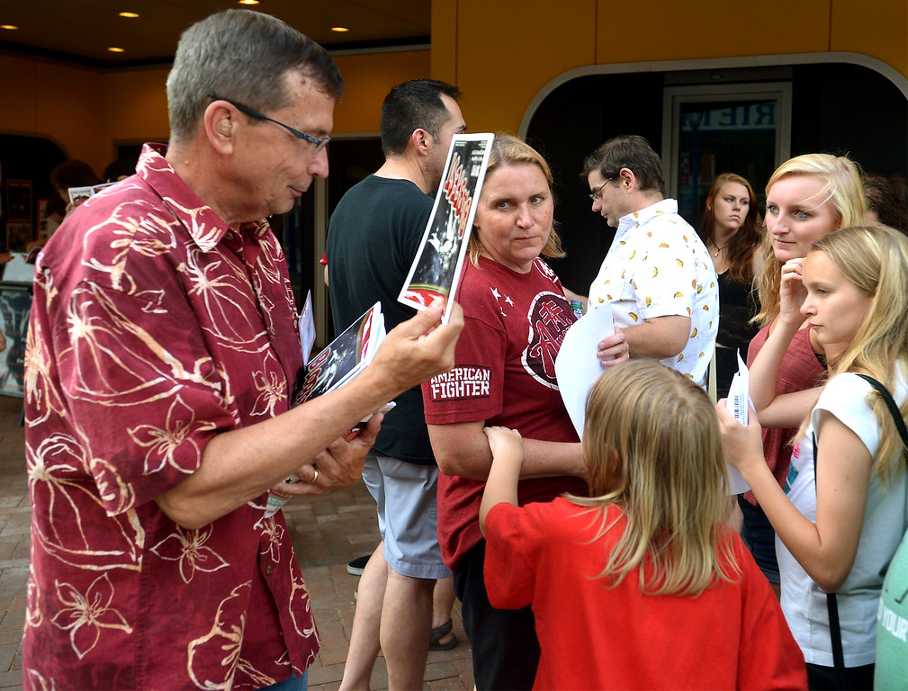 . Blobfest volunteer Paul Hartmann hands out programs to the people waiting in line outside of the Colonial Theater July 8, 2016. _ Bob Raines | Digital First Media