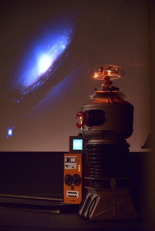 ". B-9 Robot, from the ""Lost in Space\"" television series, appears to gaze at a galaxy projected on the screen at Blobfest as the theme from \""2001: A Space Odyssey\"" plays July 8, 2016. _ Bob Raines 