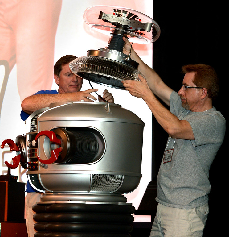 . Blobfest volunteers try to repair Robbie the Robot before the show starts July 8, 2016. _ Bob Raines | Digital First Media
