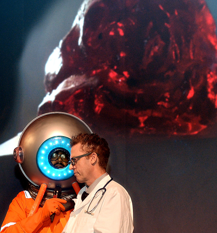 . Dr. Frank N. Stone, right and Mr. Lobos talk about sci-fi movies at Blobfest 2016 at the Colonial Theater, Phoenixville July 8, 2016.projected behind them is The Blob._ Bob Raines | Digital First Media