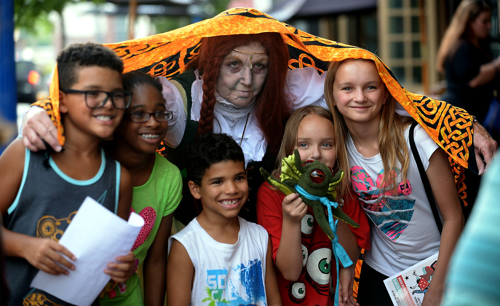 . Moira the Banshee spreads her shawl over some new friends for a photo before the Colonial Theater opens its doors for Blobfest July 8, 2016. _ Bob Raines | Digital First Media