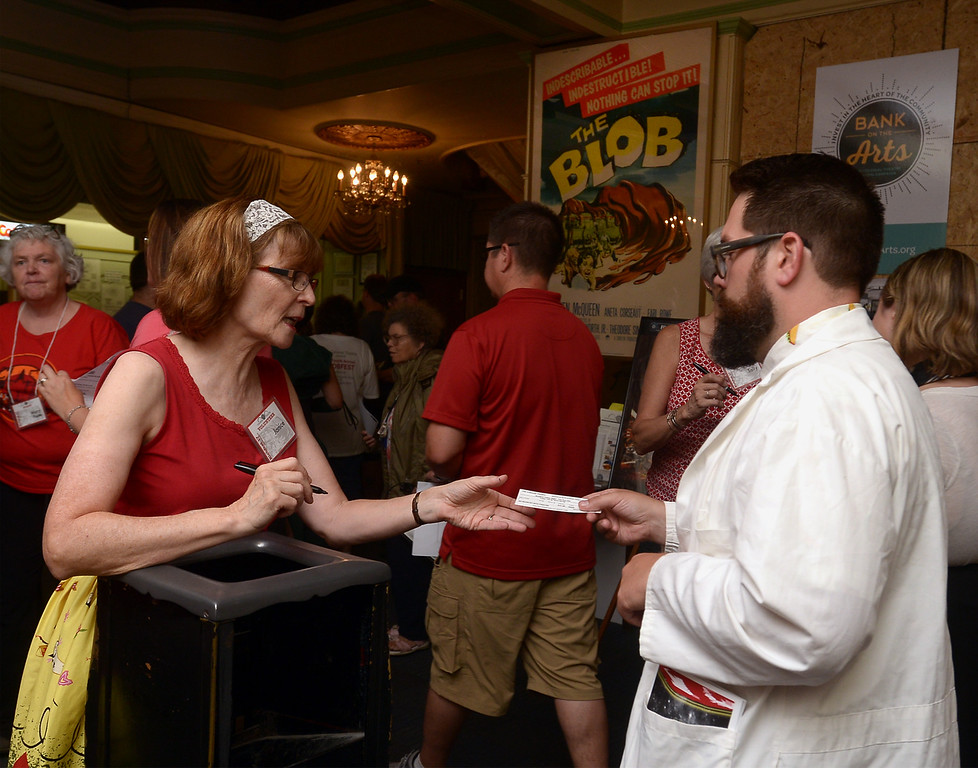 . Blobfest fan hands over his ticket before finding a seat July 8, 2016. _ Bob Raines | Digital First Media