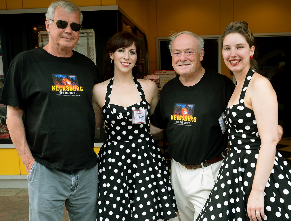 . Bill Cicciotti, left, and Brian McAndrew pose for a photo with Blobfest volunteers Kimberly Trate, left, and Elizabeth Francisco in front of the Colonial Theater July 8, 2016. The two men just returned from a supposed UFO site in Kecksburg, PA. _ Bob Raines | Digital First Media