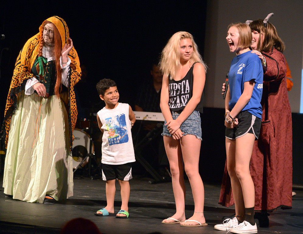". Three kids pulled from the audience by ""The Patient People\"" take part in a screaming contest during Blobfest 2016 at the Colonial Theater, Phoenixville July 8, 2016._ Bob Raines 