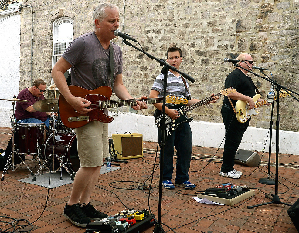 . The band Adam Mirabile and Some Old Friends plays in Phoenixville\'s Children\'s Plaza before the Colonial Theater opens its doors for Blobfest July 8, 2016. _ Bob Raines | Digital First Media