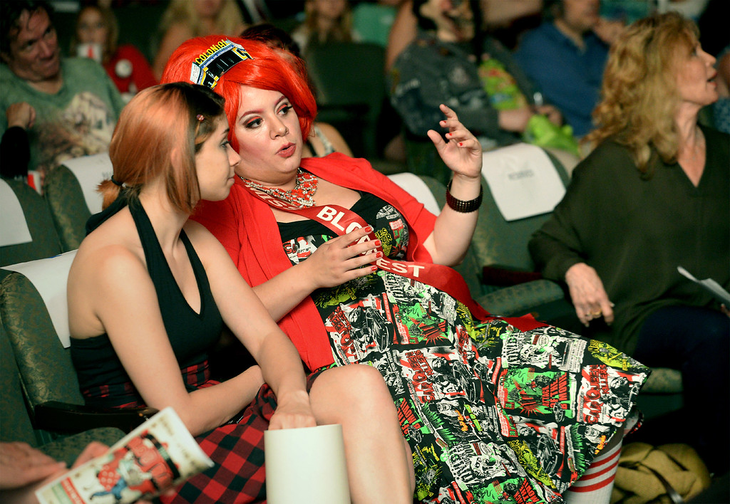 . Dixie Dellamorto, Miss Blobfest 2015, goes over a few things with the cue card person before the start of the show July 8, 2016. _ Bob Raines | Digital First Media