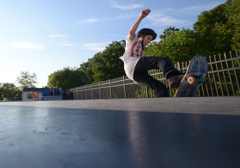 Bob Raines--Digital First Media | <br /> Dylan Evans pivots as he reaches the lip of the ramp as he competes in the skateboarding contest at the Indian Valley Boys and Girls Club Carnival July 15, 2016.