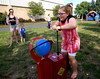 Bob Raines--Digital First Media | <br /> Abigail Lewis tries to pump up a balloon within a certain time without bursting it at the Indian Valley Boys and Girls Club Carnival July 15, 2016.