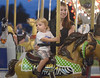 Robert Larzelere and his mother, Stephanie Strause, ride the carousel at the Dublin Firemen's Fair Aug. 12, 2016.  |  BOB RAINES--DIGITAL FIRST MEDIA