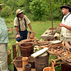 Justin Bergey, right, talks about coopering with John Suchernick, left, and Raymond Blank at the Goschenhoppen Folk Festival Aug. 12, 2016.  |  BOB RAINES--DIGITAL FIRST MEDIA