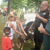 "Kids get ""up close and personal"" with a furry member of the police K-9 unit during the Community Day event at Gorgas Park Aug. 13.  Rick Cawley — For Digital First Media"