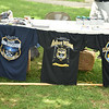 T-shirts commemorating fallen police officers sit on display during the Community Day event at Gorgas Park Aug. 13.  Rick Cawley — For Digital First Media
