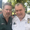 Community activist Bernie Strain poses with Fifth District police Capt. John Moroney during the Community Day event at Gorgas Park Aug. 13.  Rick Cawley — For Digital First Media