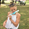 Ella Conroy finishes up her cotton candy that was literally melting in the heat during the Community Day event at Gorgas Park Aug. 13.  Rick Cawley — For Digital First Media