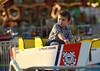 A boy pilots a U.S. Coast Guard boat at the Upper Gwynedd Carnival Sept. 8, 2016.  (Bob Raines--Digital First Media)