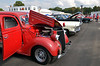 (Bob Raines--Digital First Media)   <br /> A line of vintage and custom cars await inspection at the Wings n Wheels benefit for Angel Flight East Sept. 10, 2016.