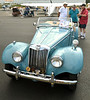 (Bob Raines--Digital First Media)   <br /> Marc Tapper, left, and Ken Greaves, center talk to John Zemany about his 1954 MG TF at the Wings n Wheels benefit for Angel Flight East Sept. 10, 2016.