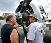 (Bob Raines--Digital First Media)   <br /> Frank Mikus, left, and Fury Colubriale look at the huge radial engine in this 1955 North American T288 at the Wings n Wheels benefit for Angel Flight East Sept. 10, 2016.