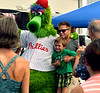 (Bob Raines--Digital First Media)   <br /> Sean Clime-Michaels and his son, Sean Loeb, get a photograph with the Phillie Phanatic at the Wings n Wheels benefit for Angel Flight East Sept. 10, 2016.