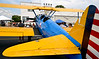 (Bob Raines--Digital First Media)   <br /> Ronald Gersten's 1941 Stearman PT17 biplane provides shade for people listen to the band at Wings n Wheels benefitting Angel Flight East Sept. 10, 2016.