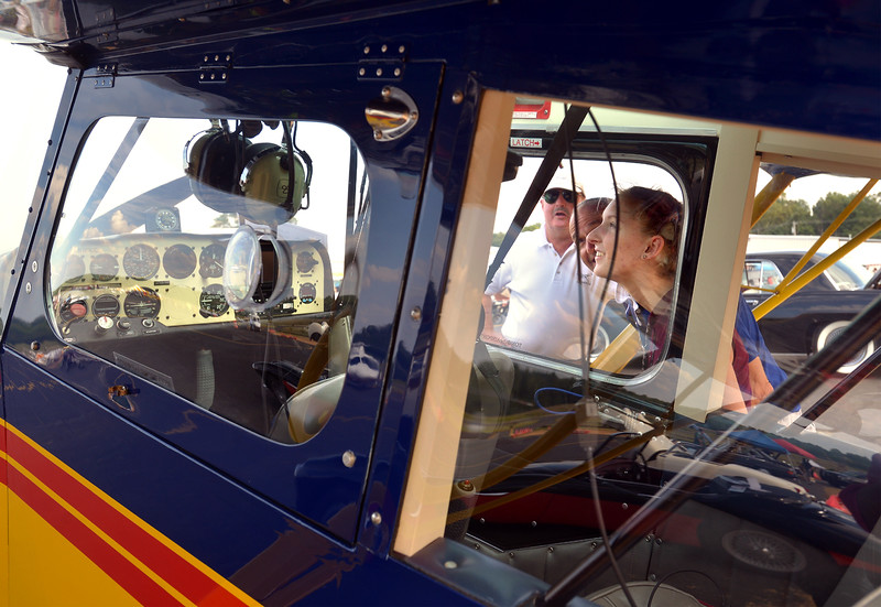 (Bob Raines--Digital First Media)   <br /> Heather Conlan and her father look inside the cockpit as owner Tom Beaver talks about his plane, a 2001 American Champion, Model 76CAA Sept. 10, 2016.