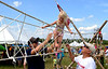 (Bob Raines--Digital First Media)   <br /> Brynlee Davis makes her way along a rope bridge with help from her father, Kevin Davis, and her grandfather, Kurt Dietrich, at the Wings n Wheels benefit for Angel Flight East Sept. 10, 2016. Boy Scout Troop 98 constructed this bridge and a wooden ferris wheel at Wings Field.