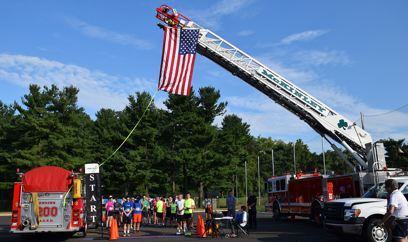 Debby High — For Digital First Media<br /> A moment of silence to recognize the 15th anniversary of 9/11 is held before the start of the 5K.