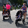 Debby High — For Digital First Media<br /> Brian and Elizabeth Boyle each pushed their children, twins Brinley and Bethany and 4-year-old Bridgett in Eastern Montgomery County Chamber of Commerce's fourth annual Race for the Bottom Line 5K Sept. 11.