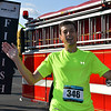 Debby High — For Digital First Media<br /> Vitaly Beloterkovsky celebrates crossing the finish line first in Eastern Montgomery County Chamber of Commerce's fourth annual Race for the Bottom Line 5K Sept. 11.