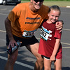 Debby High — For Digital First Media<br /> Joe Kulak runs with his 8-year-old daughter, Lauren, in Eastern Montgomery County Chamber of Commerce's fourth annual Race for the Bottom Line 5K Sept. 11.