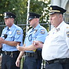 Rick Cawley — For Digital First Media<br /> Capt. Carl Holmes, left, Officer Ian Gwyn, Officer Chris Jones and Fifth District Capt. John Moloney, all of the Philadelphia Police Department, hold candles during the 21st Ward Veterans Association Service of Remembrance in Gorgas Park marking the 15th anniversary of the 9/11 attacks.