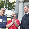 "Rick Cawley — For Digital First Media<br /> John Barkley, left, Linda Marie Bell and Lt. David Kelly of the Salvation Army perform an uplifting rendition of ""The Star-Spangled Banner."""